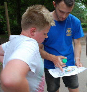 Volunteer showing young person map reading skills