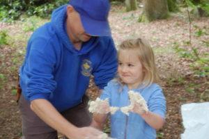 Volunteer teaching cooking and bushcraft skills